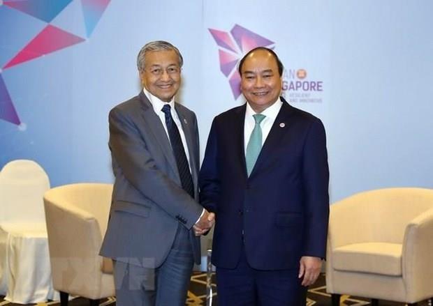 Malaysian PM's visit to strengthen Vietnam-Malaysia partnership hinh anh 1