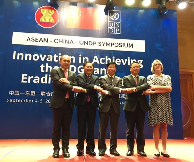 ASEAN, China, UNDP exchange ideas on poverty reduction hinh anh 1