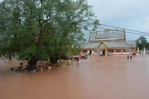 Leaders extend sympathies to Laos over losses by devastating floods hinh anh 1