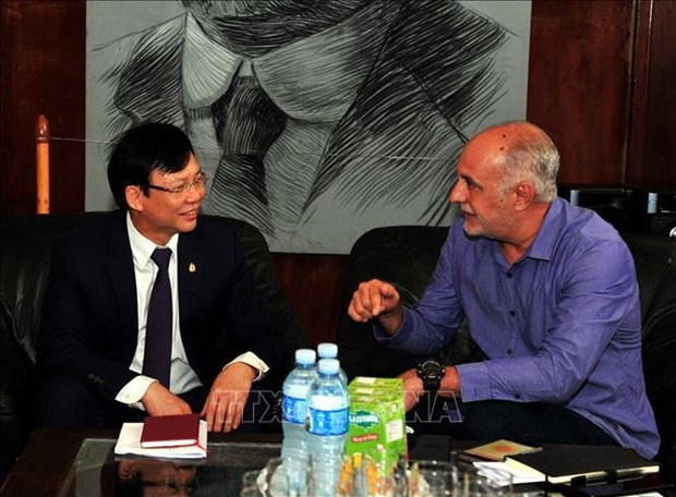 Vietnamese, Cuban journalists' associations exchange professional experience hinh anh 1