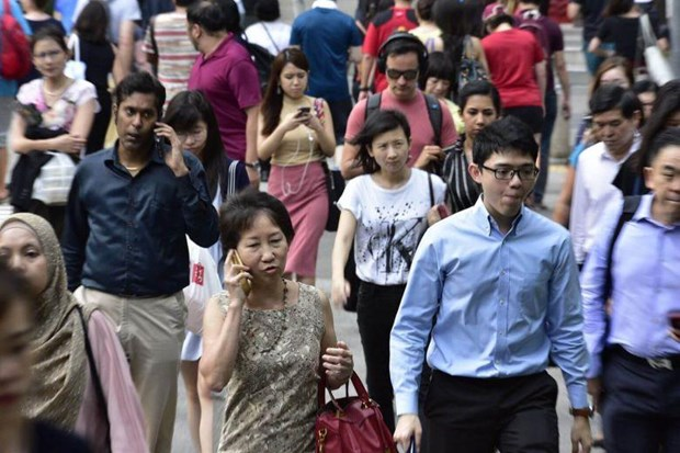 Unemployment rate in Singapore inches up 3.3 percent in Q2 hinh anh 1