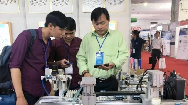 Electricity, printing industry exhibition chain opens in HCM City hinh anh 1