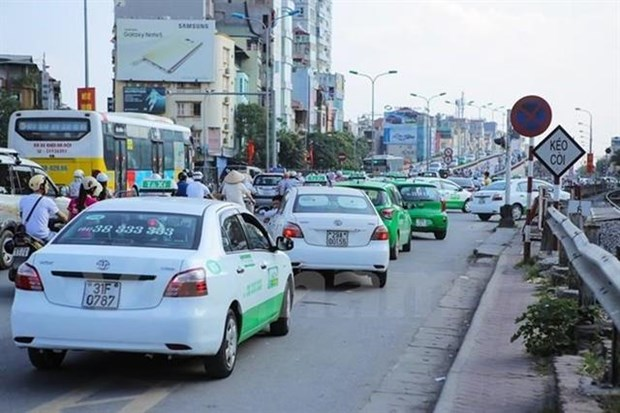 Hanoi's taxis may have same colours by 2026 hinh anh 1
