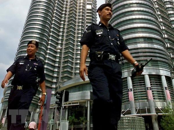 Malaysia arrests 15 over links to Islamic State hinh anh 1