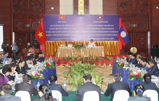 Legislatures of Vietnam, Laos share experience at joint workshop hinh anh 1