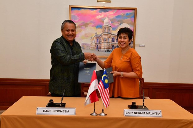 Malaysia, Indonesia sign 2-billion-USD currency swap deal hinh anh 1