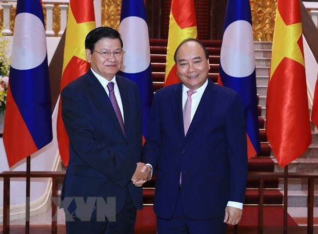 Vietnam-Laos relations of special solidarity enjoy substantive progress hinh anh 1