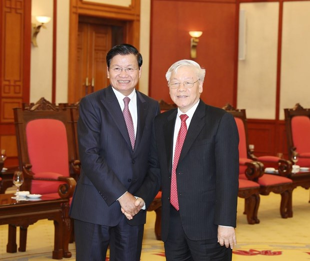 Top leader welcomes Lao PM in Hanoi hinh anh 1