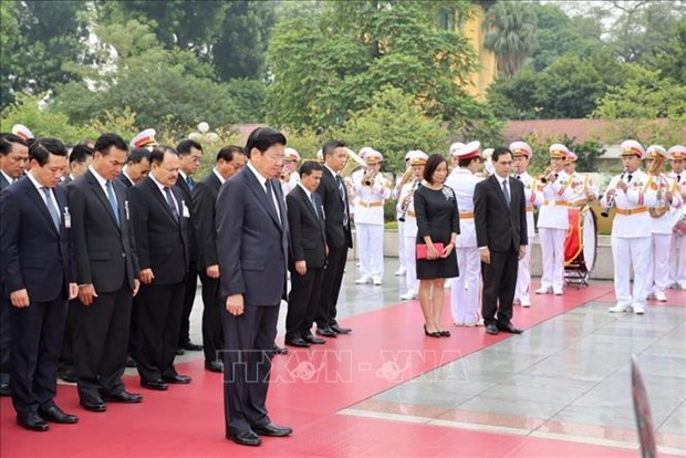 Lao PM concludes official visit to Vietnam hinh anh 1