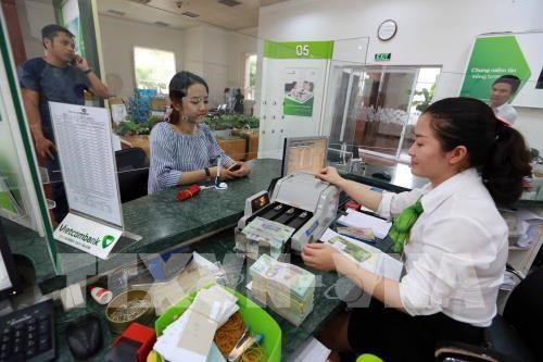 Reference exchange rate continues to go down on October 3 hinh anh 1