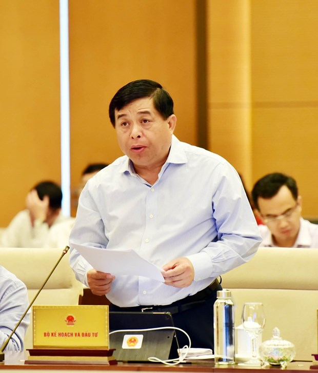 Legislators deliberate reports on socio-economic development hinh anh 1