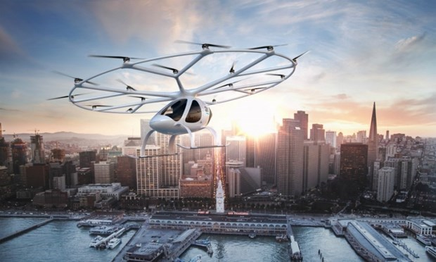 Volocopter air taxi flies over Marina Bay in Singapore hinh anh 1