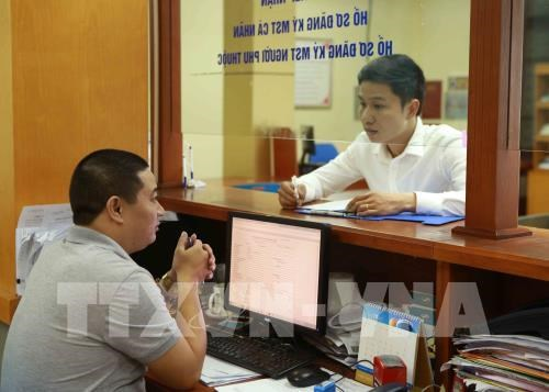 Vietnam's ease of paying taxes improves: World Bank hinh anh 1