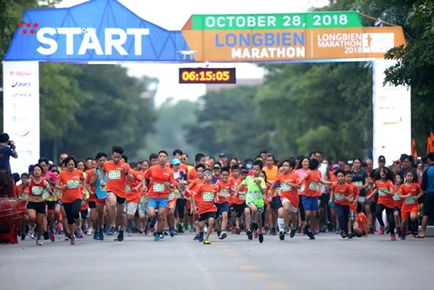 Almost 6,000 athletes to compete in Longbien Marathon hinh anh 1