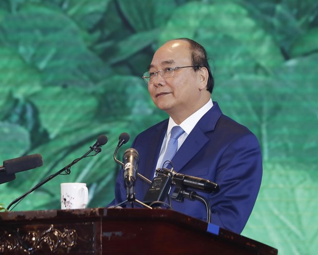 PM's attendance in summits aims to enhance ASEAN solidarity hinh anh 1