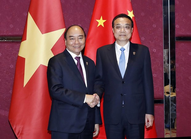 PM Nguyen Xuan Phuc holds meetings on ASEAN Summit's sidelines hinh anh 2