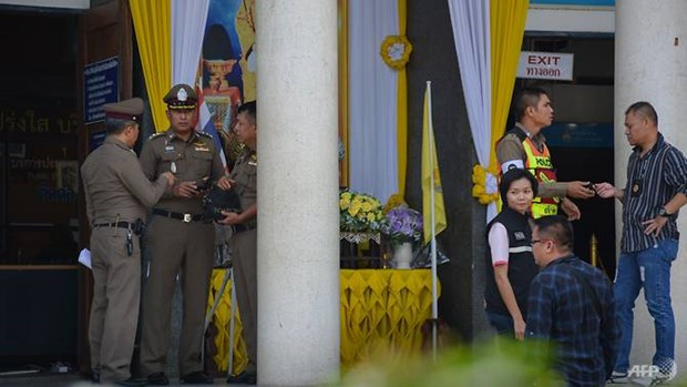 Thai clerk charged with murder after shooting gunman in court hinh anh 1