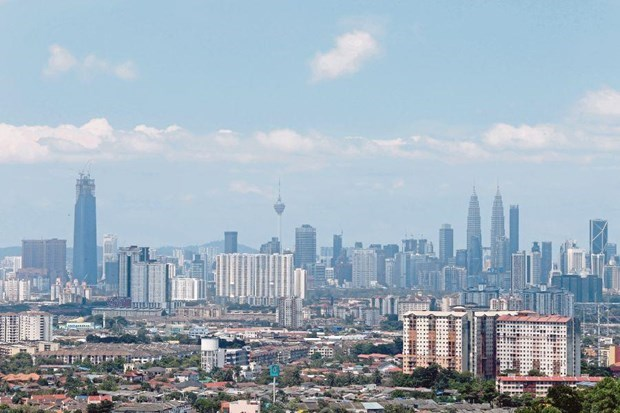 Malaysia's economic growth slows down in Q3 hinh anh 1
