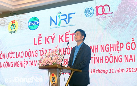 Dong Nai: wood firms ink collective labour agreement hinh anh 1
