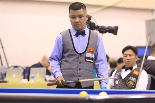 Vietnamese cueists win first match at three cushion billiard world event hinh anh 1