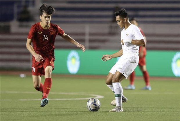 SEA Games 30: Vietnam score thrilling 2-1 comeback win over Indonesia hinh anh 2