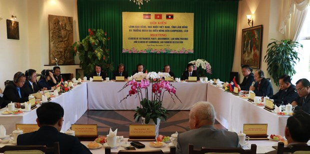 Programme boosts ties among Vietnamese, Lao, Cambodian farmers hinh anh 1