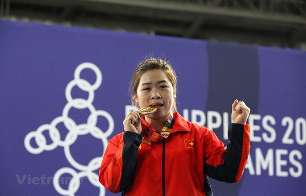 SEA Games 30: Wushu artist brings first gold for Vietnam in 3rd competition day hinh anh 2