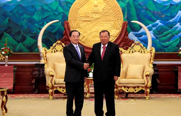 Chairman of Presidential Office meets Lao Party leader hinh anh 1