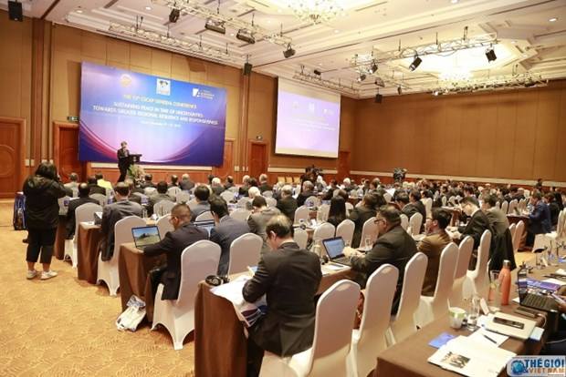 Int'l workshop discusses peace sustaining amid uncertainties hinh anh 1