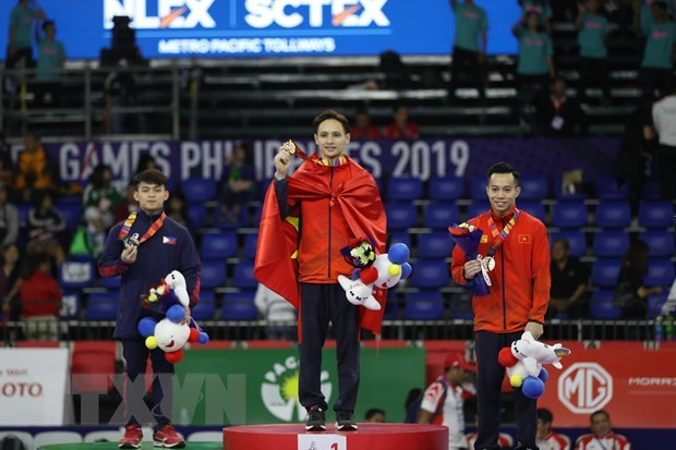 SEA Games 30: Vietnam stays at second place on December 5 hinh anh 1