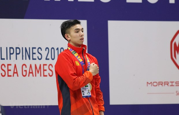 Swimmer Huy Hoang smashes SEA Games record hinh anh 1