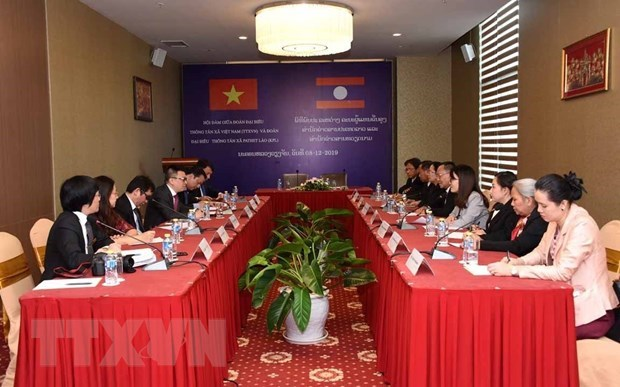 Vietnamese, Lao news agencies forge cooperation to raise information quality hinh anh 1