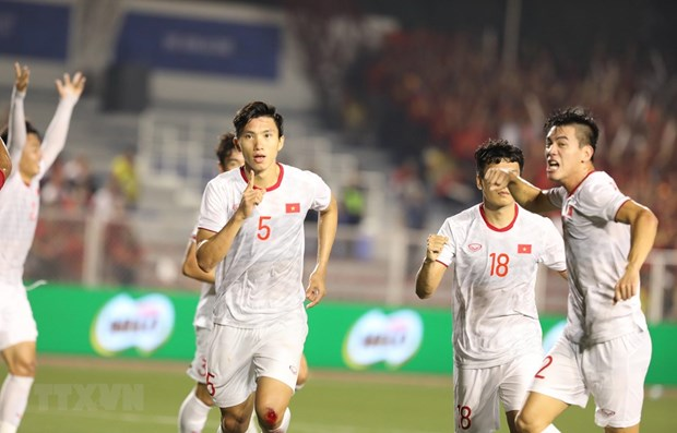 Sea Games 30: Asia media praise Vietnamese football's historic win hinh anh 1