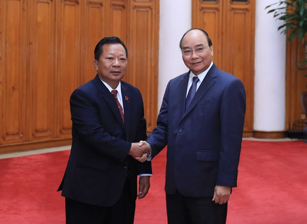 PM welcomes Cambodian, Lao defence ministers hinh anh 3