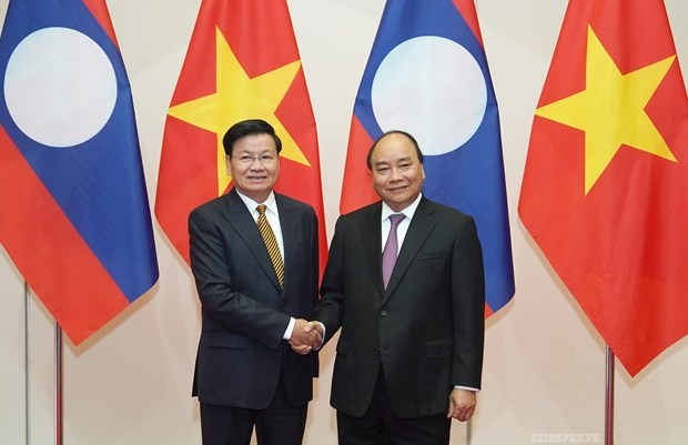 Vietnam remains Laos' important partner: magazine hinh anh 1