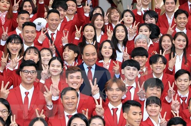 PM hails efforts of Vietnam sports delegation at SEA Games 30 hinh anh 1