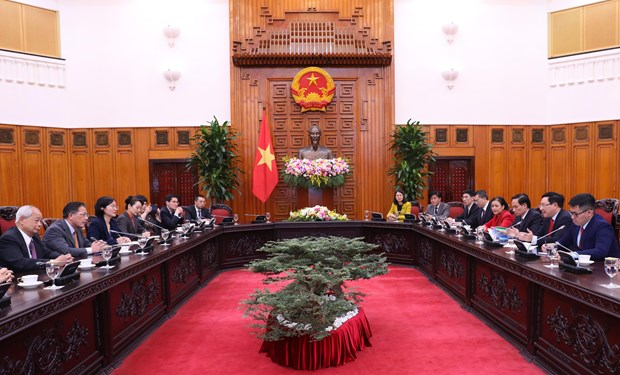 Deputy PM meets delegates to Vietnam-China People's Forum hinh anh 1