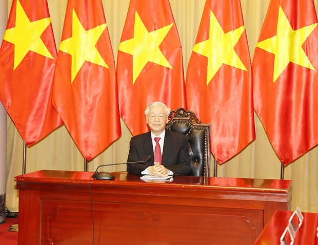 Top leader's message on Vietnam's assumption of ASEAN, UNSC positions hinh anh 1