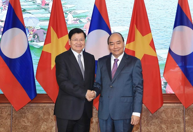 Lao PM concludes Vietnam visit hinh anh 1