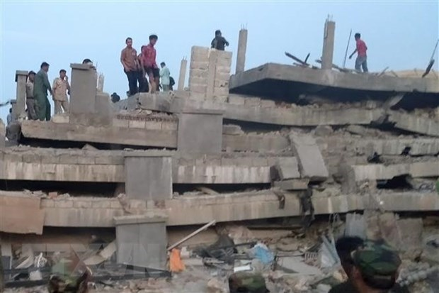 36 dead, 23 rescued from collapsed building in Cambodia hinh anh 1