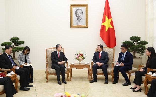 Deputy PM Vuong Dinh Hue receives Chinese Ambassador hinh anh 1