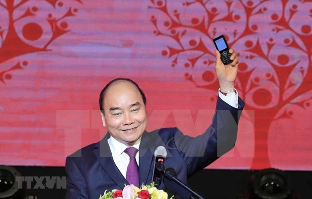 PM calls on Vietnamese to support poor people ahead of Tet hinh anh 1