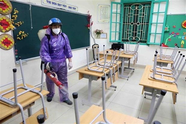 Hanoi, Ho Chi Minh City schools to stay shut for another week hinh anh 1