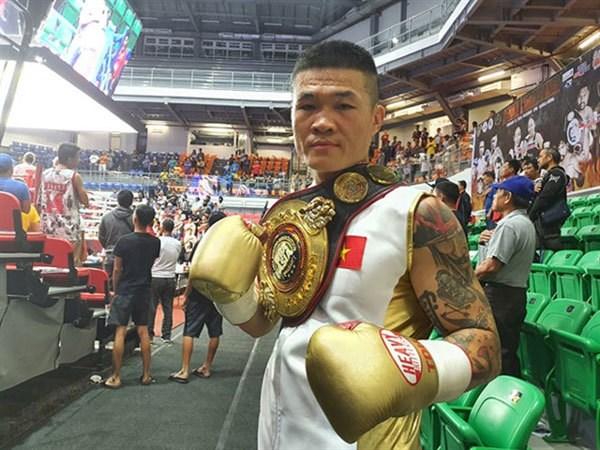 Vietnamese boxer retains WBA Asia title hinh anh 1