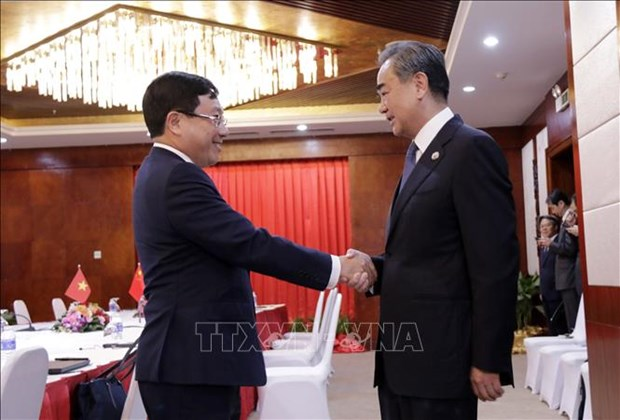 Deputy PM, FM meets with Chinese, Lao foreign ministers hinh anh 2