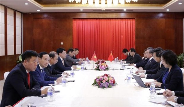 Deputy PM, FM meets with Chinese, Lao foreign ministers hinh anh 1