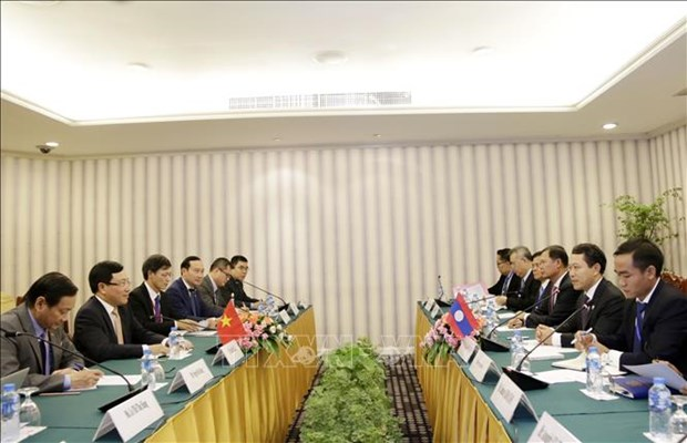 Deputy PM, FM meets with Chinese, Lao foreign ministers hinh anh 3