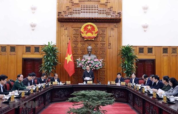 PM: no treatment discrimination but resolute quarantine against COVID-19 hinh anh 1