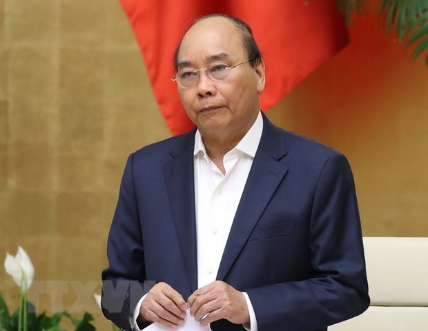 PM instructs giving maximum assistance to production, business amid COVID-19 hinh anh 1