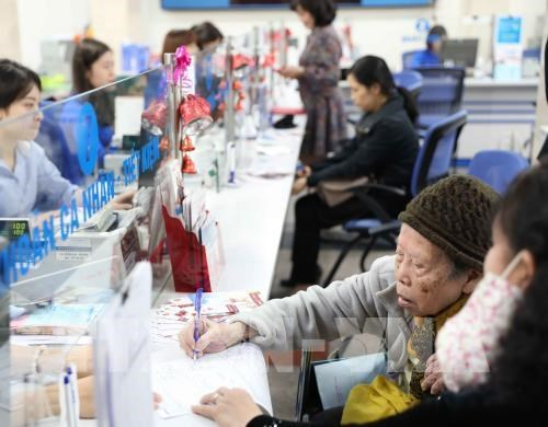 Banks to provide over 12-billion-USD credit to epidemic-hit firms hinh anh 1